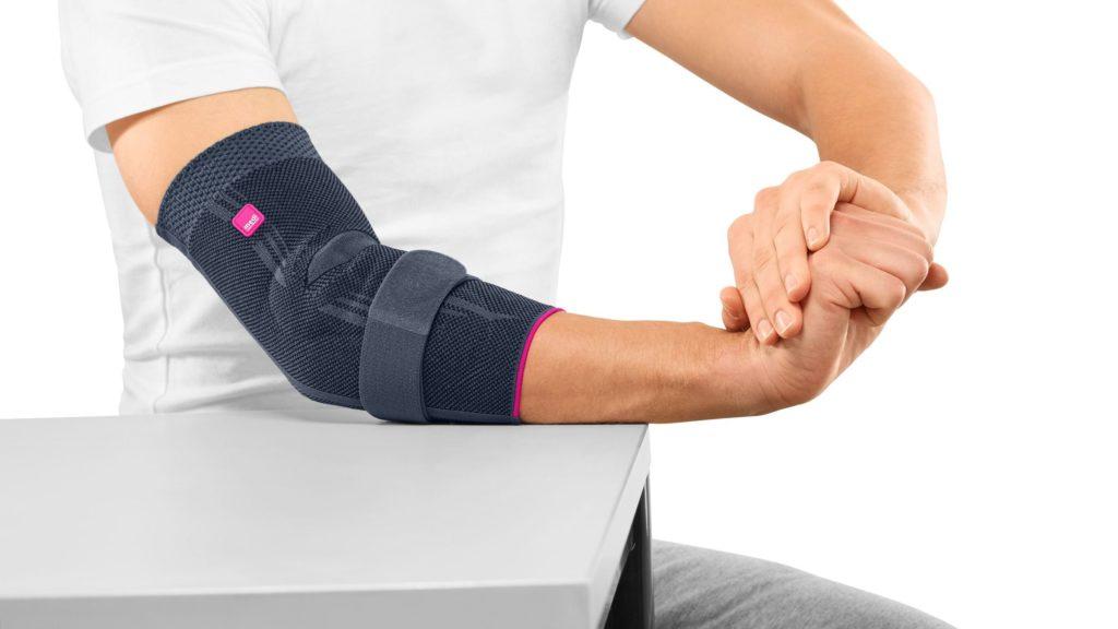 Повязка на локоть, позволяющая снизить нагрузку на сустав